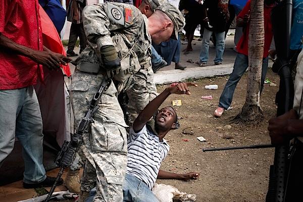 US Soldier Haiti food line.jpg