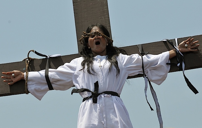 Filipina nailed to cross.jpg