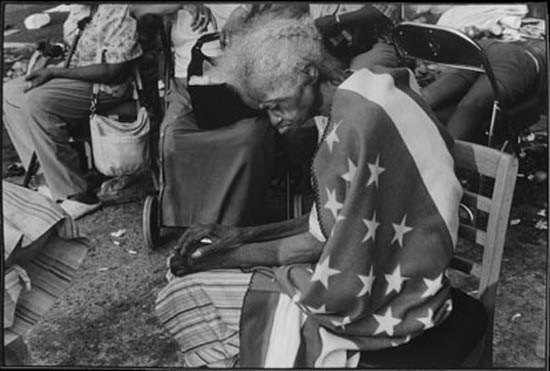 Alan Chin's photo of a Katrina victim in a flag